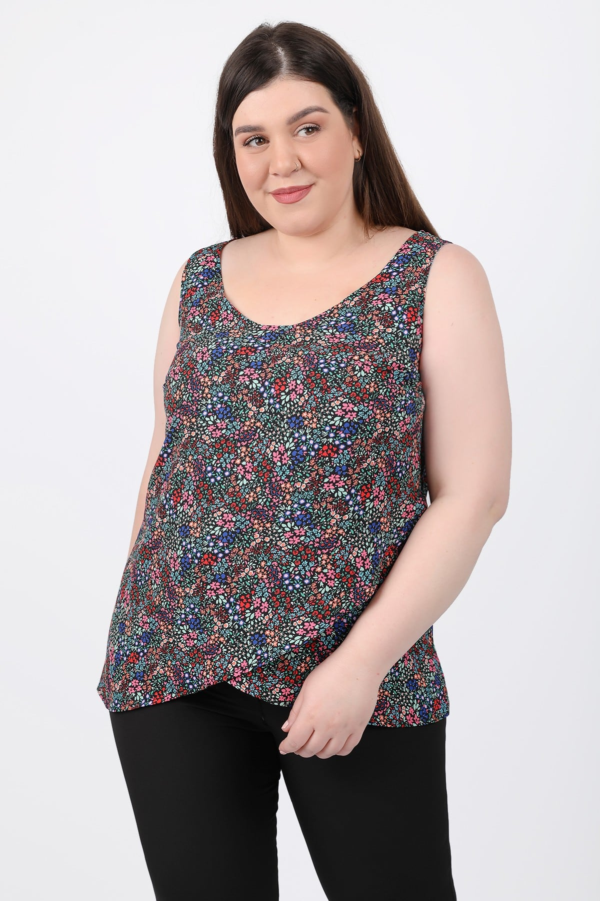 Sleeveless floral top with wrap hem