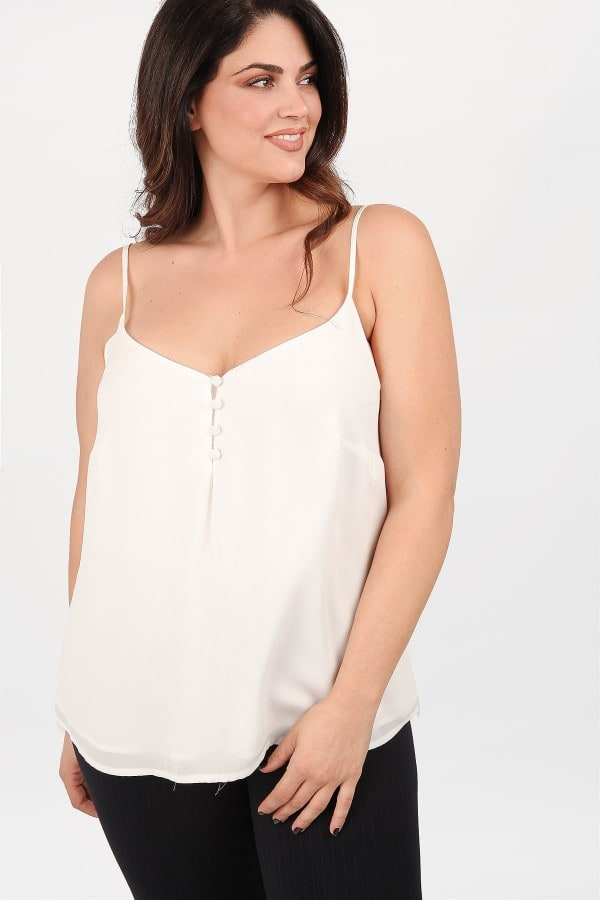 Sleeveless top adorned with covered buttons
