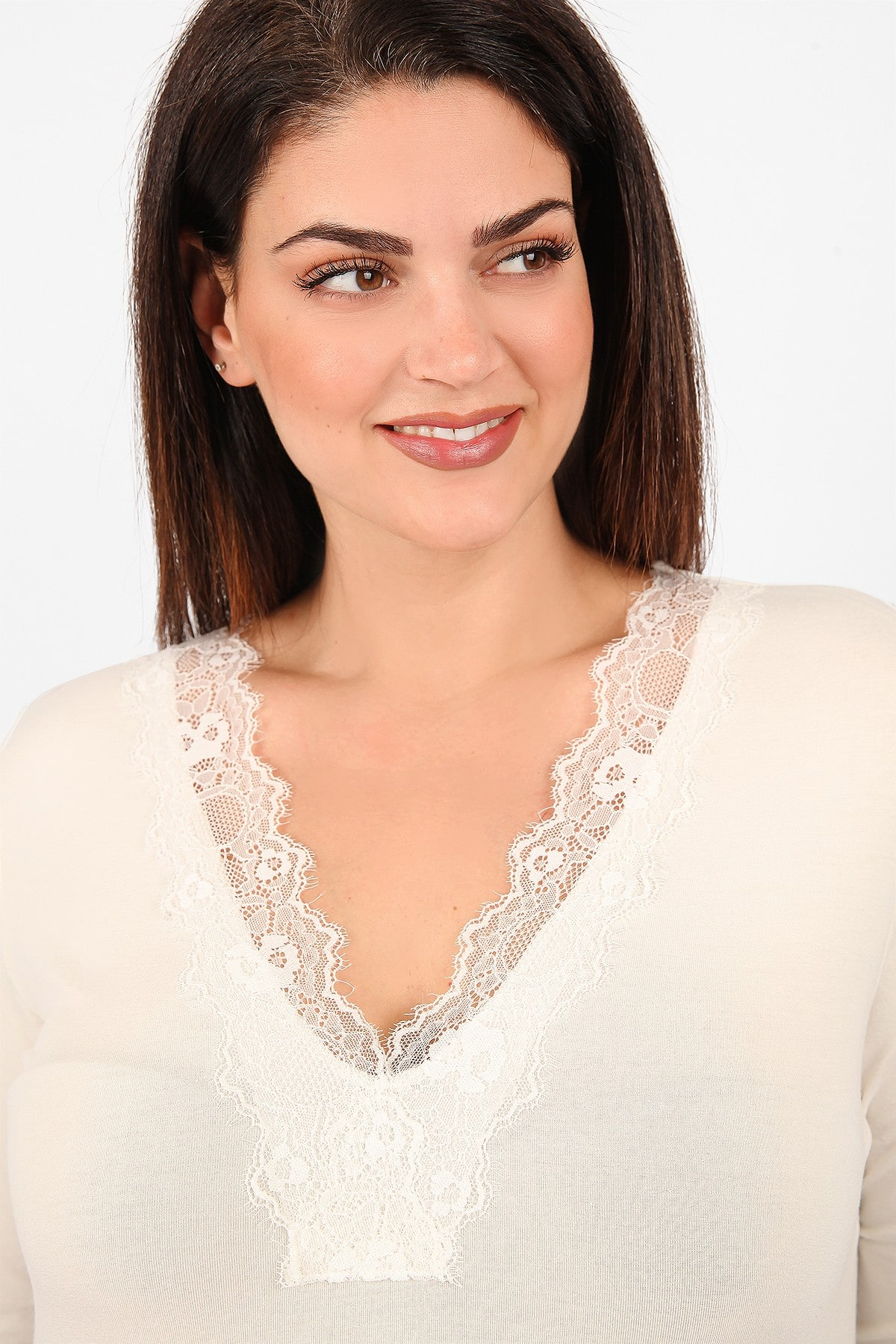 Blouse with lace on the V