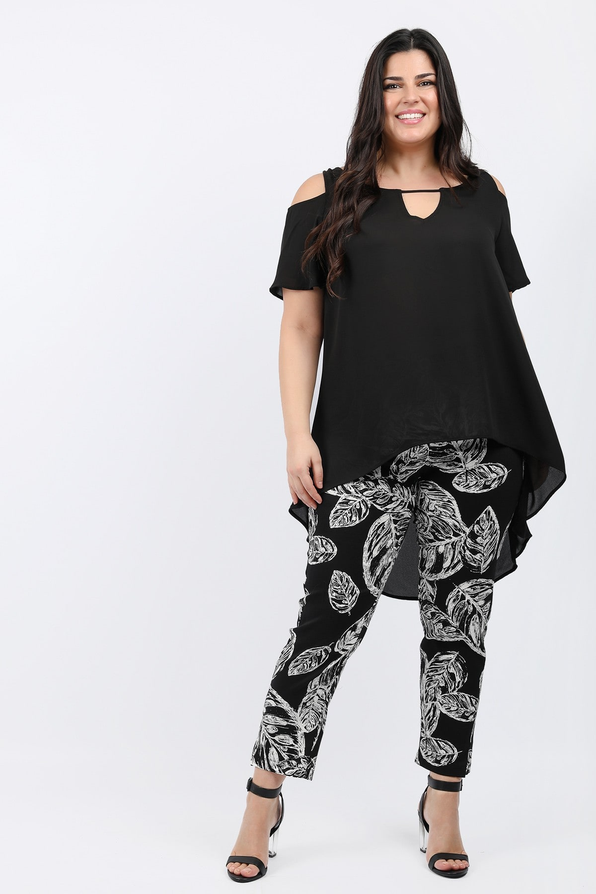 Airy asymmetrical blouse with cold shoulder and flare sleeves