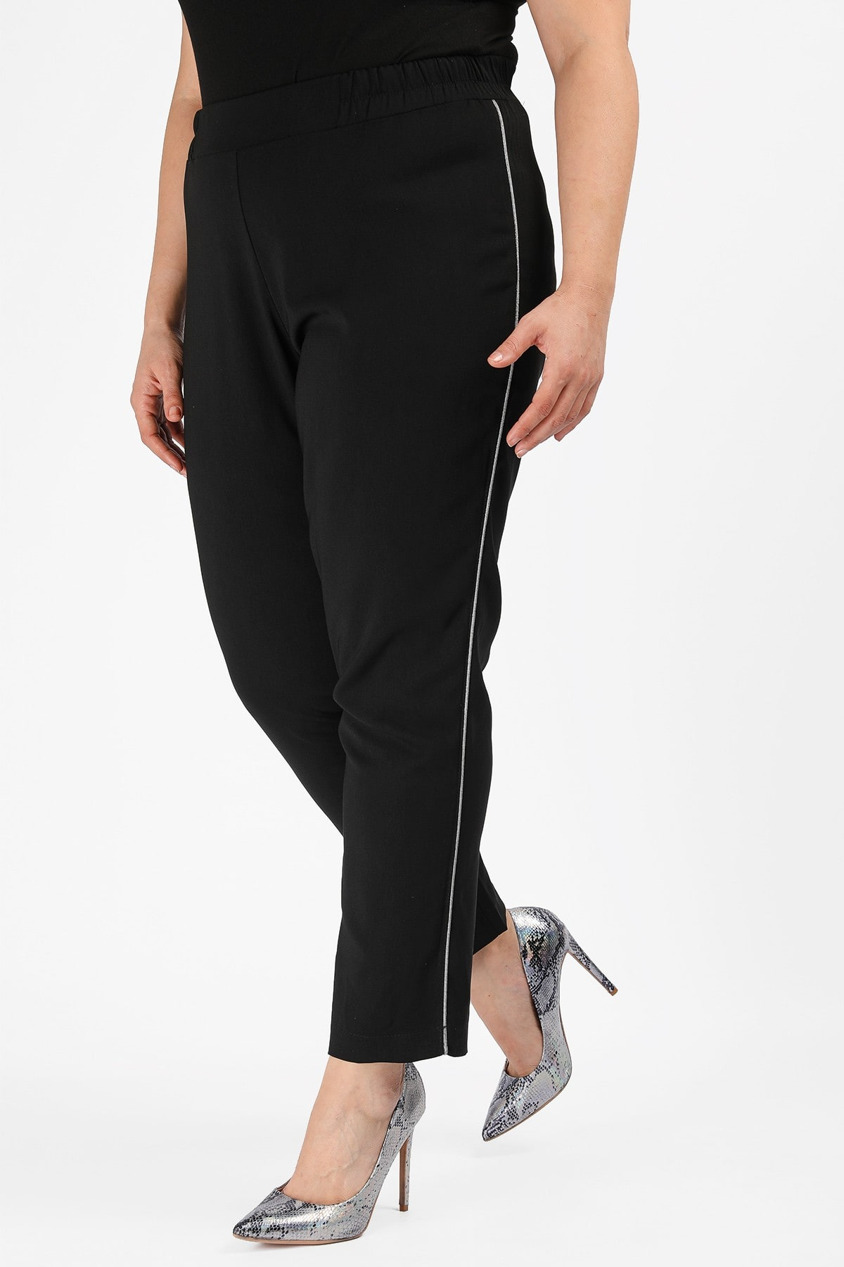 Tapper trousers with silver stripe on the side