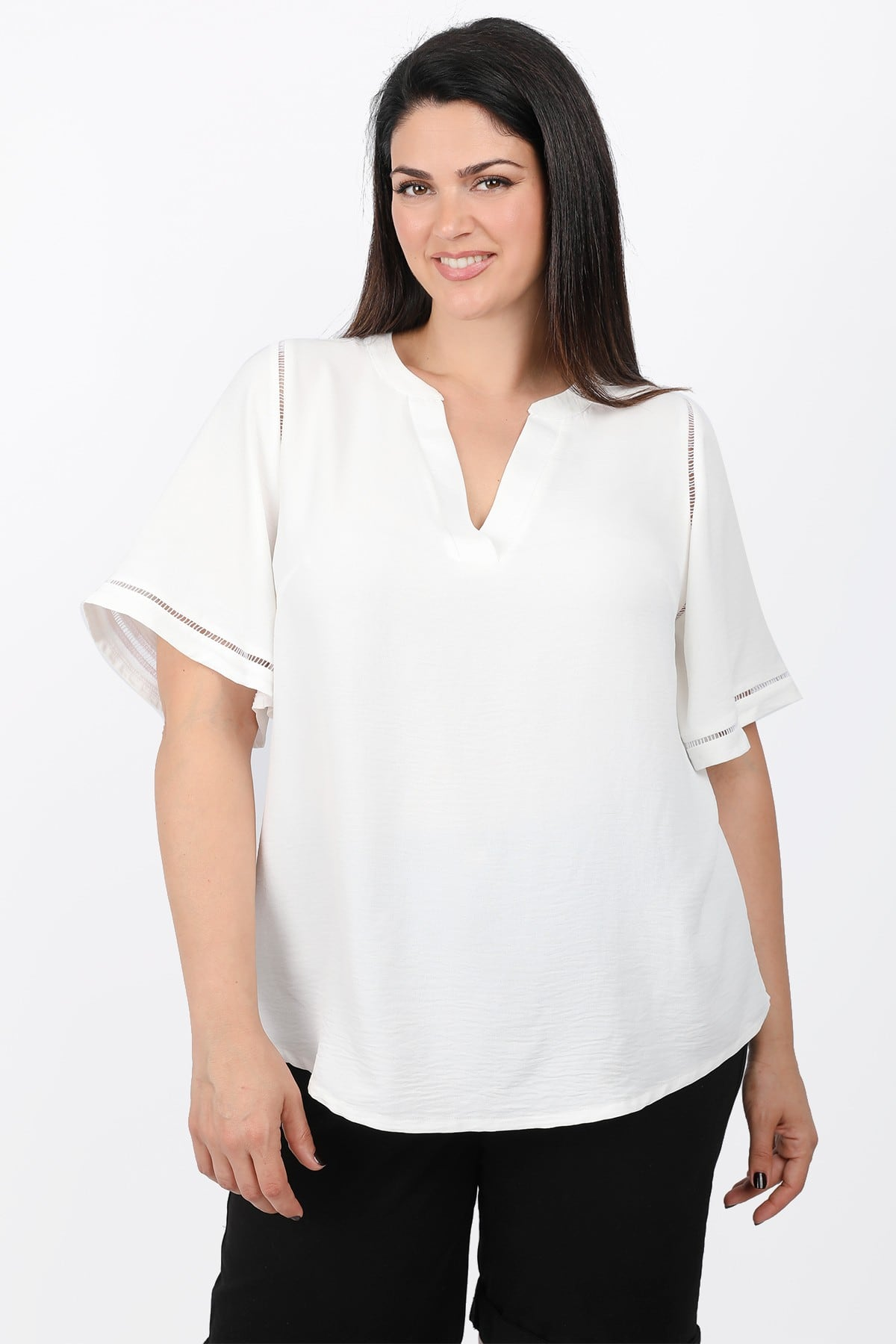 Blouse with perforated details
