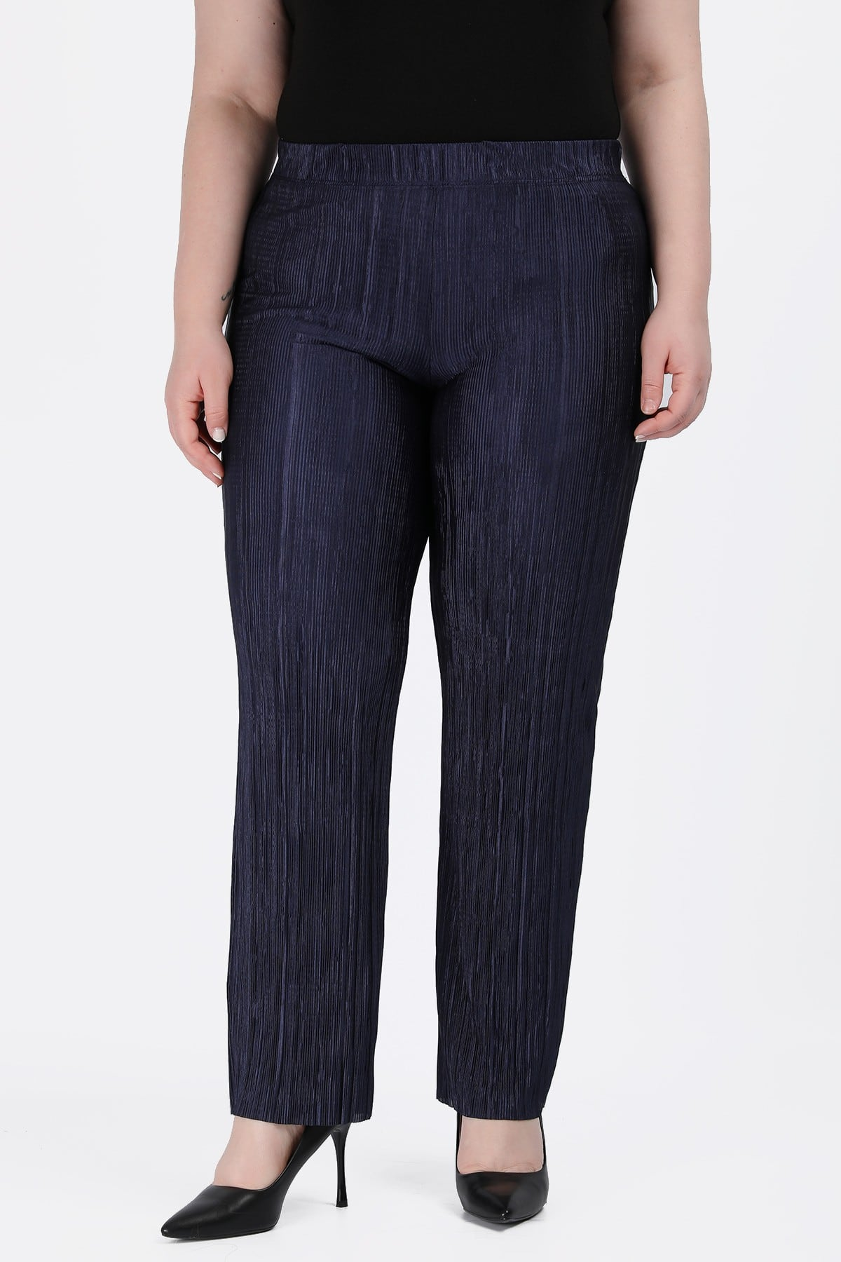 Αccordion pleated trousers from shiny texture