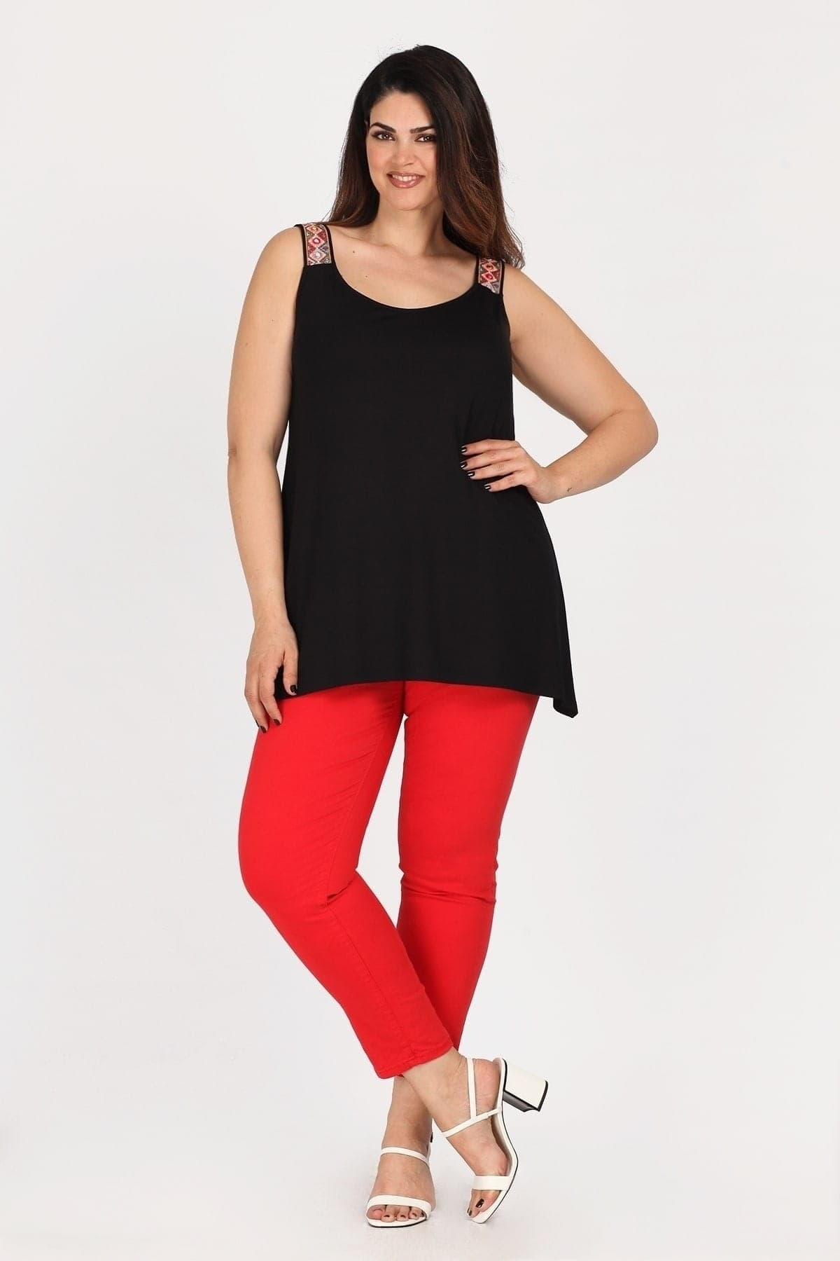 Top with asymmetric hem  studs on the straps
