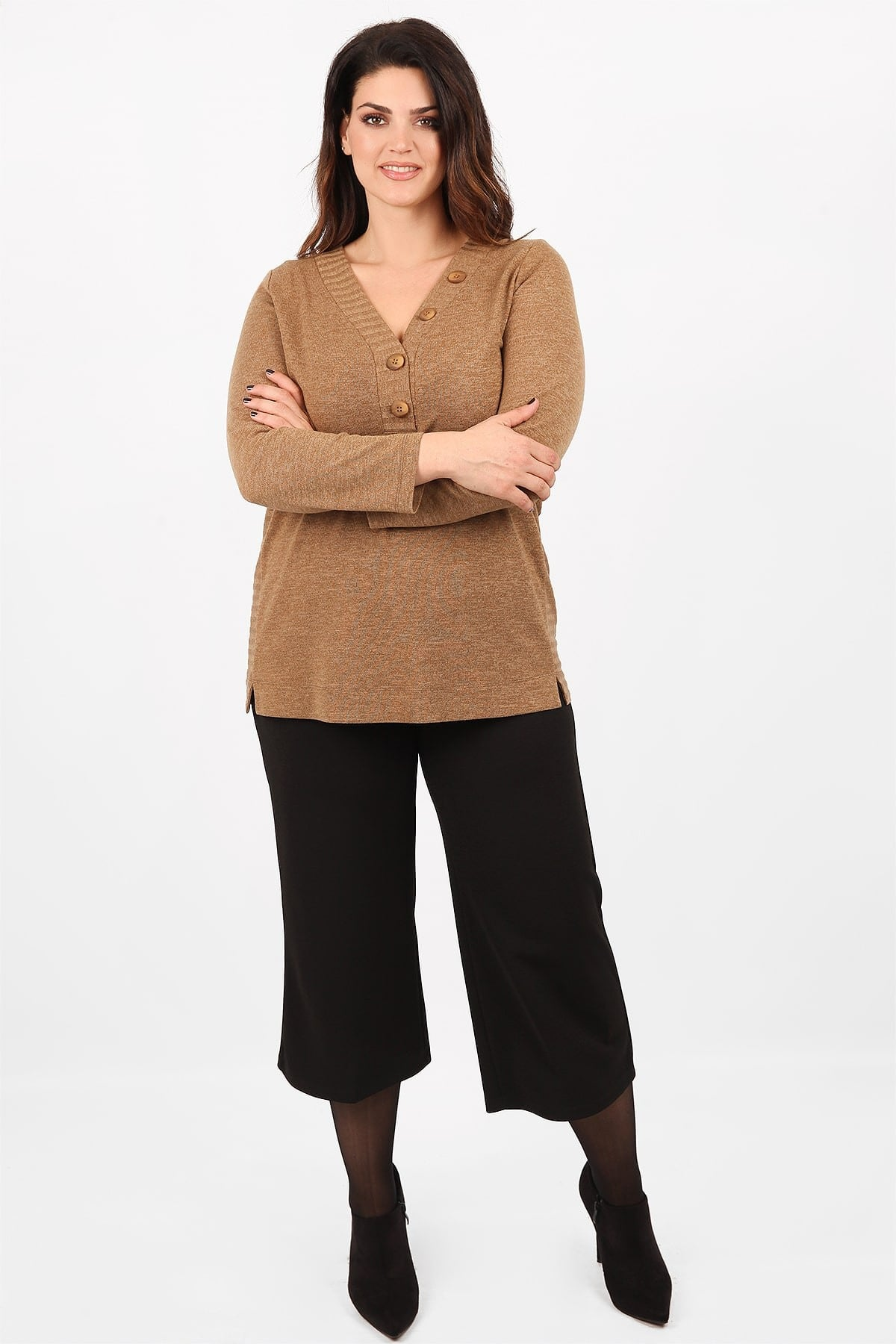 Knit blouse with rib detail and buttons on the V