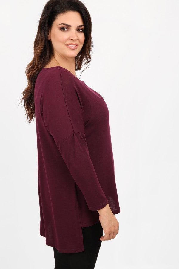 Knit blouse in straight-fit with longer back