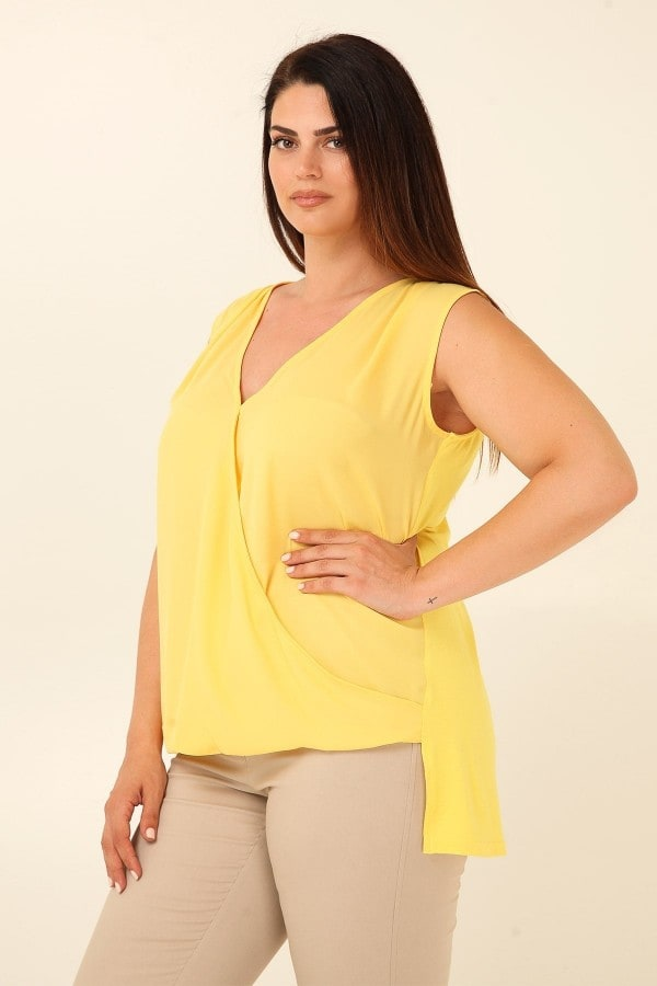 High-low sleeveless draped wrap blouse