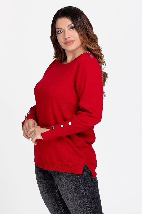 Knit blouse adorned with buttons on the shoulders and cuffs