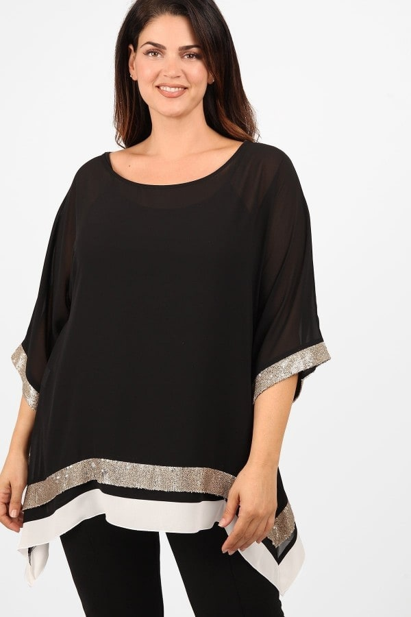 Evening tunic with sequins on hem