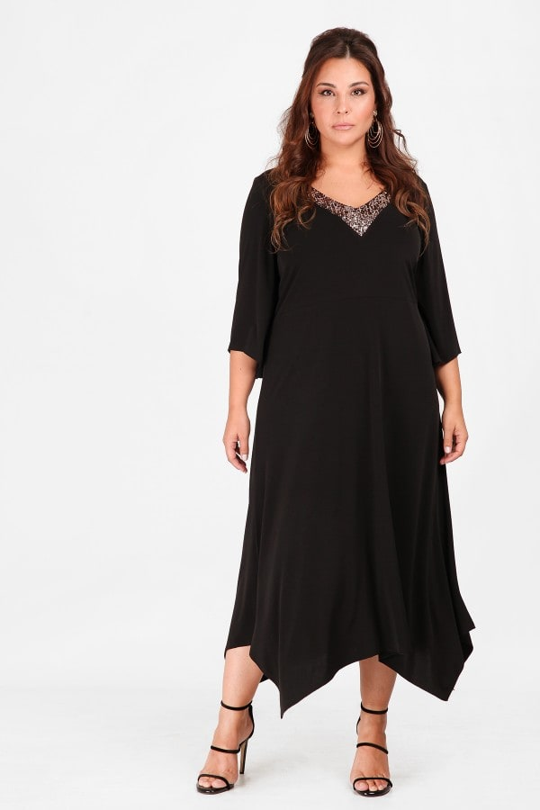 Αsymetrical maxi dress with sequins on the V