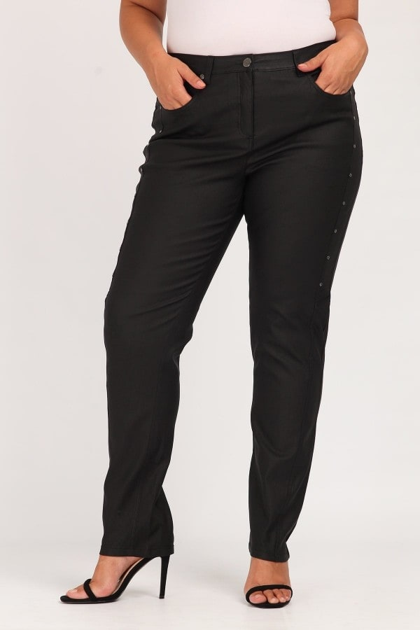 Faux leather coated trousers with studs
