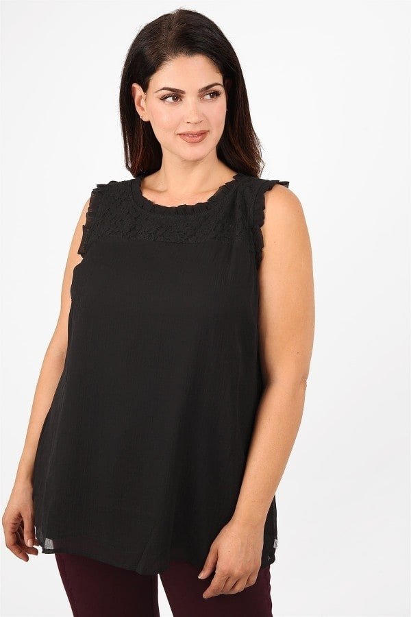 Ruffled top with laced details