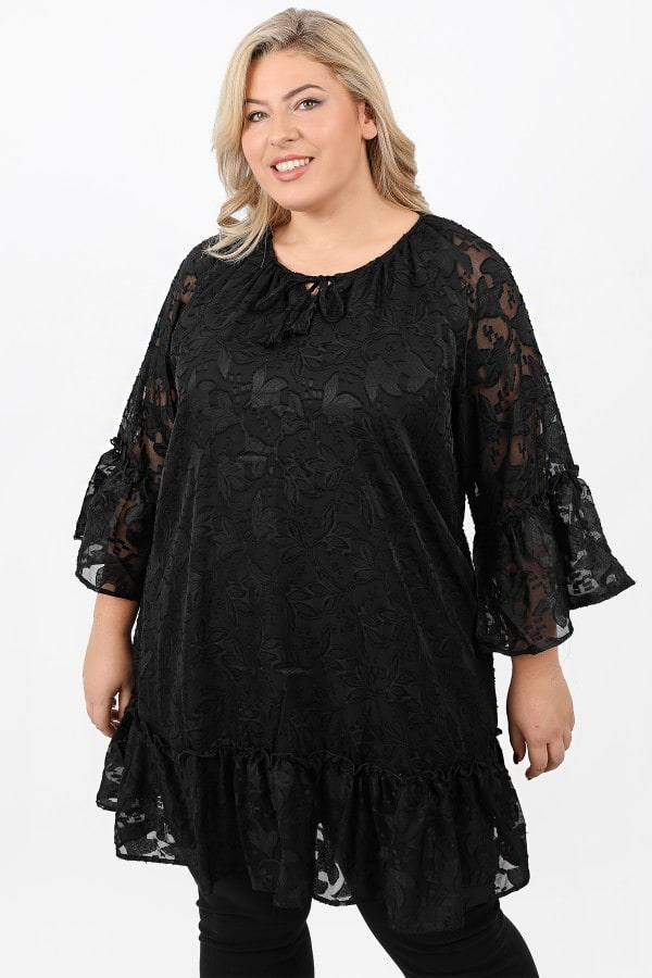 Tunic from embossed lace and ruffled hems